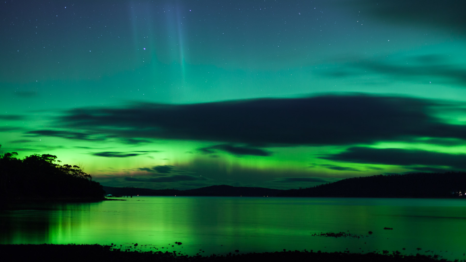 Hues of green shimmers across the night sky - Aurora Australis Southern Lights