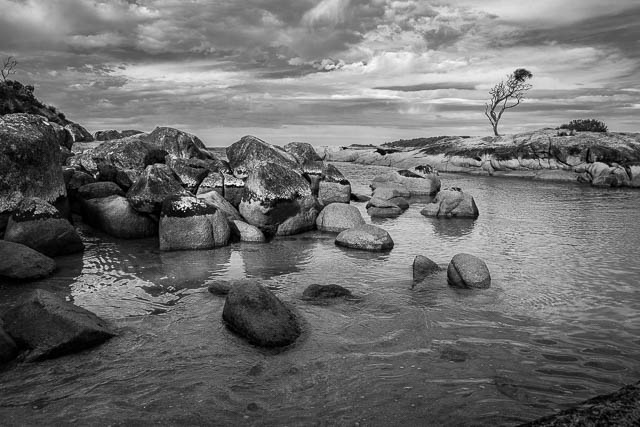Autumn twilight in black and white on Bay of Fires in Tasmania.