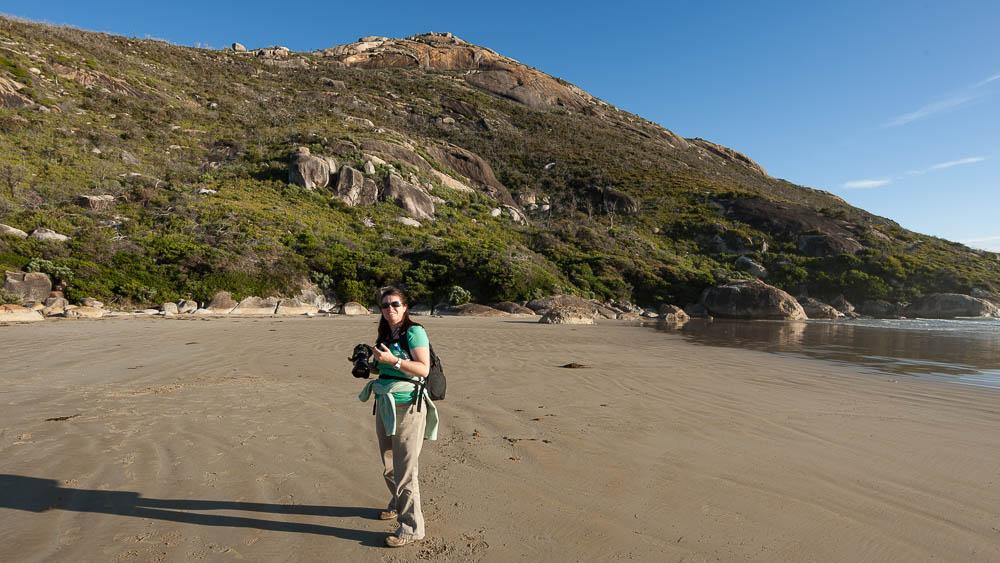female photographer with camera on beach