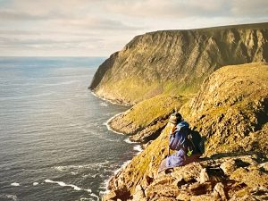 Sitting atop a cliff looking out over the Norwegian Sea and Arctic ocean to the North Pole, Nordkapp Norway